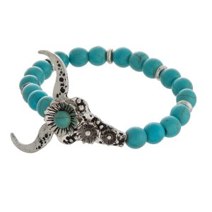 """Stretch bracelet with various charm detail. Charm is approximately 1"""" in length."""