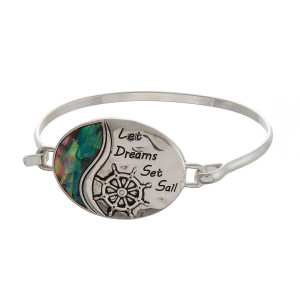 Metal bracelet with stamped saying and abalone detail.