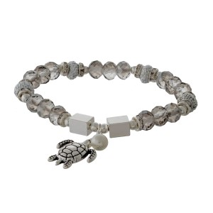 Silver tone and gray beaded stretch bracelet with a sea life charm.