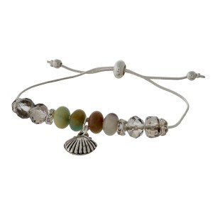 Dainty silver tone bracelet with amazonite beads, a sea life charm, and a pull-tie closure.