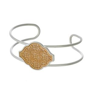 Two tone metal bracelet with filigree design.