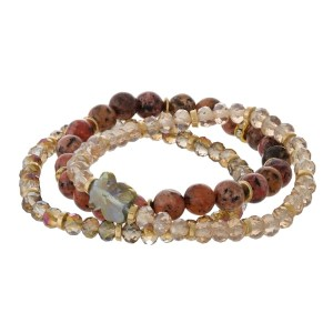 Three piece, natural stone beaded bracelet set with gold tone accents.