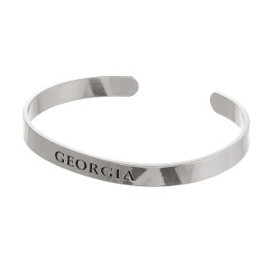 Dainty, metal cuff bracelet with the stamped state.