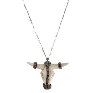"Silver toned necklace with steer head resin pendant . Approximately 24"" in length with a 2"" pendant."