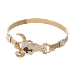 Burnished metal, bangle bracelet with a steer head focal.