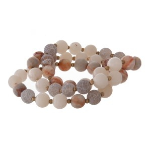 Stretch bracelet with natural stone, faceted, and metal beads.