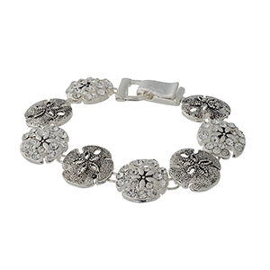 "7 1/2"" around silver tone bracelet featuring sand-dollars with rhinestone details."