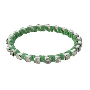 Silver rhinestone bangle wrapped in green suede.