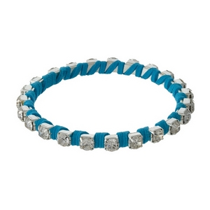 Silver rhinestone bangle wrapped in blue suede.
