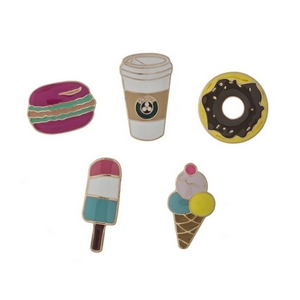 "Set of five gold tone pins in the shapes of ice cream, coffee, donuts, popsicles, and macaroons. All pins approximately 3/4"" in size."