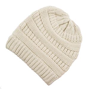 Ivory knit beanie. 100% acrylic.