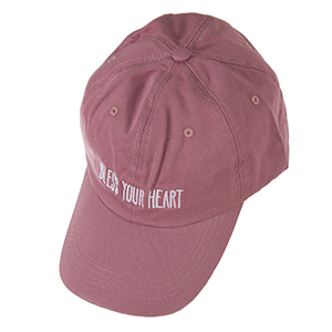 "Mauve hat with a velcro adjustable back, embroidered with ""Bless Your Heart."""