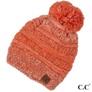Cable knit, confetti print C.C beanie with pom pom, in orange. 100% acrylic.