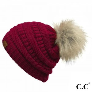 Cable knit, original C.C beanie with a faux fur pom pom, in burgundy. 100% acrylic.