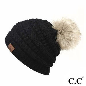 Cable knit, original C.C beanie with a faux fur pom pom, in black. 100% acrylic.