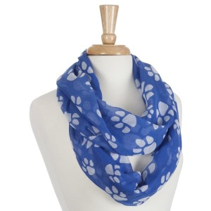Lightweight blue infinity scarf with white paw prints. Made of 100% polyester.