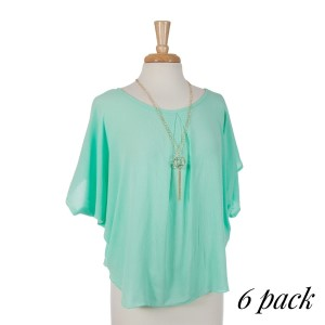 Mint green scoop neck short sleeve top with removable gold tone tassel necklace. 100% rayon. Sold in packs of six - one small, two mediums, two larges, one extra large.