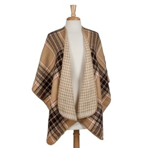 Tan, black and white reversible kimono with houndstooth and plaid. 100% acrylic. One size fits most.