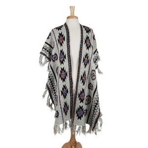 Gray kimono with an Aztec print and fringe details. 50% acrylic, 50% polyester. One size fits most.