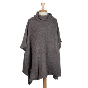 Gray short sleeve, turtle neck poncho top with a cable knit pattern. 100% acrylic. One size fits most.