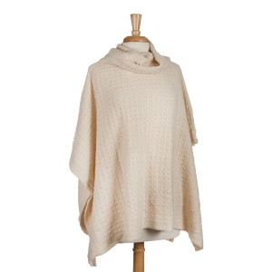Ivory short sleeve, turtle neck poncho top with a cable knit pattern. 100% acrylic. One size fits most.