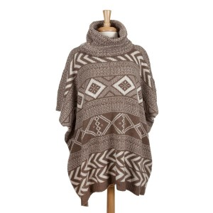 Heavyweight taupe and white Aztec printed, turtleneck poncho top with short sleeves. 100% acrylic. One size fits most.