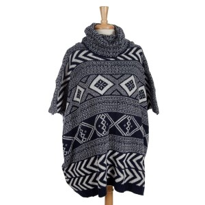 Heavyweight navy blue and white Aztec printed, turtleneck poncho top with short sleeves. 100% acrylic. One size fits most.