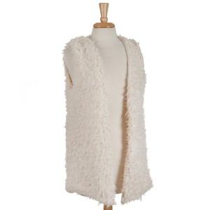 Ivory faux fur vest with pockets and a hidden hook closure. 100% polyester. One size fits most.