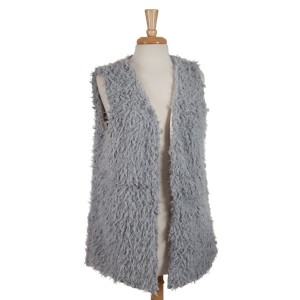Gray faux fur vest with pockets and a hidden hook closure. 100% polyester. One size fits most.