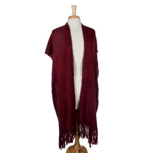Burgundy short sleeve knit duster with fringe. 100% acrylic. One size fits most.