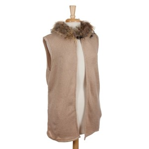 Beige vest with a raccoon fur trimmed hood, a front hook closure and pockets. 68% acrylic, 15% polyester, 17% spandex. One size fits most.