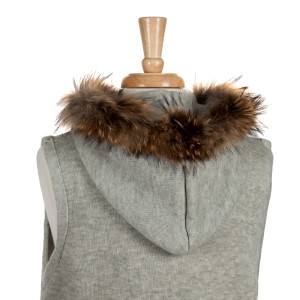 Light gray vest with a raccoon fur trimmed hood, a front hook closure and pockets. 68% acrylic, 15% polyester, 17% spandex. One size fits most.