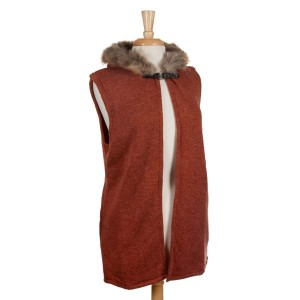 Rust orange vest with a raccoon fur trimmed hood, a front hook closure and pockets. 68% acrylic, 15% polyester, 17% spandex. One size fits most.