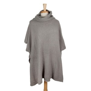 Gray short sleeve, turtleneck poncho. 100% acrylic. One size fits most.
