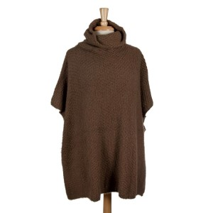 Taupe short sleeve, turtleneck poncho. 100% acrylic. One size fits most.