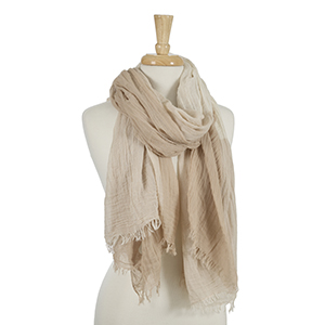 "Beige and ivory open scarf with frayed edges. 45% viscose and 55% cotton. Measures approximately 38"" x 80."""