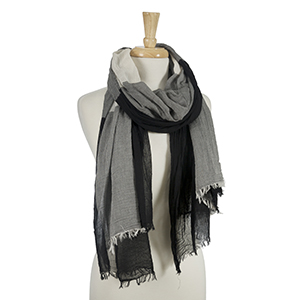 "Black and light gray open scarf with frayed edges. 45% viscose and 55% cotton. Measures approximately 38"" x 80."""