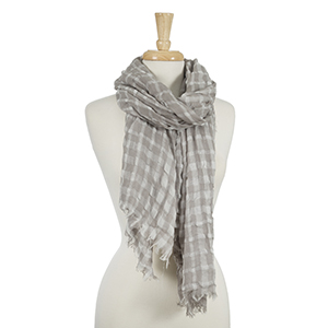 "Lightweight gray and white gingham printed scarf with frayed edges. 100% viscose. Measures approximately 33"" x 76."""
