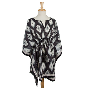 Lightweight black and gray poncho with an ikat pattern and a cinch waist. 100% cotton. One size fits most and can be worn as a swimsuit cover up.