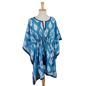 Lightweight blue and white poncho with an ikat pattern and a cinch waist. 100% cotton. One size fits most and can be worn as a swimsuit cover up.