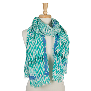 "Teal and white open scarf with a tie-dye print and royal blue accents. 100% cotton. Measures approximately 36"" x 72."""