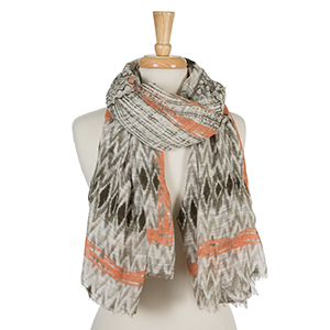"Taupe and white open scarf with a tie-dye print and peach accents. 100% cotton. Measures approximately 36"" x 72."""