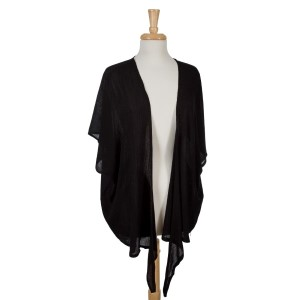 Lightweight black, short sleeve overlay with a crinkled fabric. 100% viscose. One size fits most.