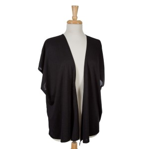 Black short sleeve open overlay. 65% viscose and 35% polyester. One size fits most.