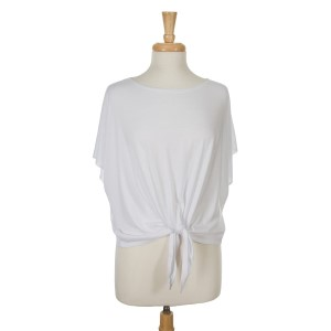 White short sleeve top with a tie front. 65% viscose and 35% polyester. One size fits most.