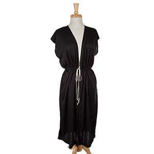 Black sleeveless, duster length vest with side slits and a tie front. 65% viscose and 35% polyester. One size fits most.
