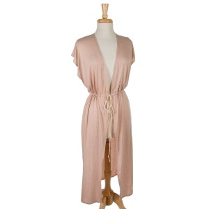 Dust pink sleeveless, duster length vest with side slits and a tie front. 65% viscose and 35% polyester. One size fits most.