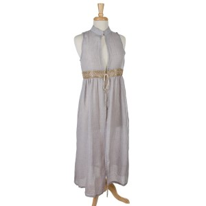Gray sleeveless, duster length vest featuring a glitter waist line and a tie front. 100% cotton. One size.