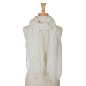 "Lightweight ivory open scarf with floral lace on the ends. 35% viscose and 65% polyester. Measures approximately 72"" x 33."""