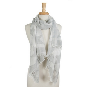 "White open scarf featuring gray stars and frayed edges. 40% cotton and 60% polyester. Approximately 28"" x 78"" in size."